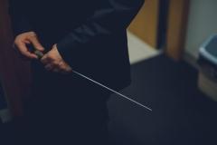 Batuta w dłoniach dyrygenta