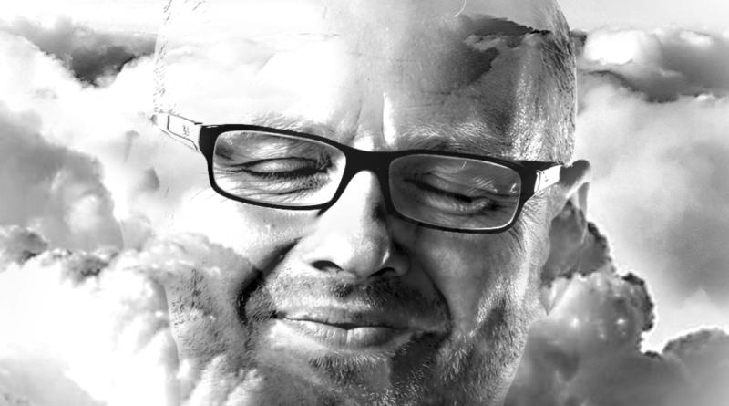 twarz mężczyzny wkomponowana w obłoki - grafika EKO przedstawiająca Leszka Sojkę