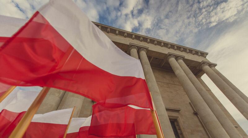 Flagi Polski, w tle Archikatedra w Katowicach